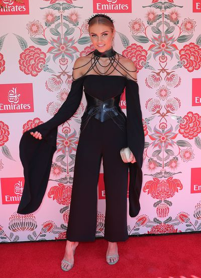 <p>Trend overload</p> <p>Elyse Knowles with full sleeves a corset and statement choker. Pantsuit from the Misha collection.</p>