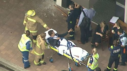 One man was taken from the scene by paramedics on a stretcher. (9NEWS)
