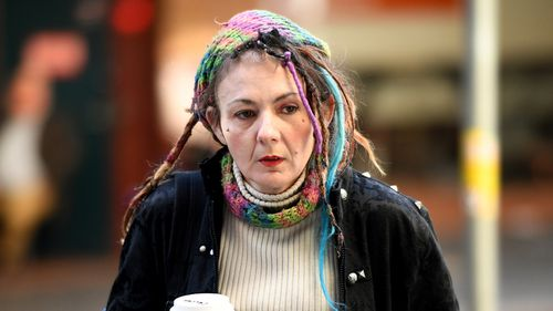 Axe attack victim Sharon Hacker arrives at the Downing Centre District Court in Sydney in July last year.