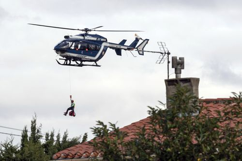 Nine helicopters have been used to rescue stranded locals after flash flooding in the Aude region of France.