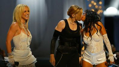 Madonna shared a kiss with Britney Spears and Christina Aguilera at VMAs.