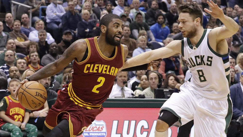 Matthew Dellavedova takes on former teammate Kyrie Irving. (AAP)