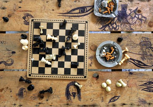 A chess board and unemptied ashtrays are seen in an abandoned house in the near-deserted and heavily-bombed village of Yaroun in southern Lebanon. Saudi Arabia's top cleric says playing chess is forbidden in Islam, describing it as a waste of time saying it leads to rivalry and enmity. (AAP)