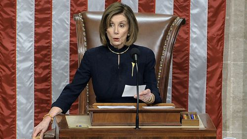 Nancy Pelosi announces the result of the first count of impeachment.