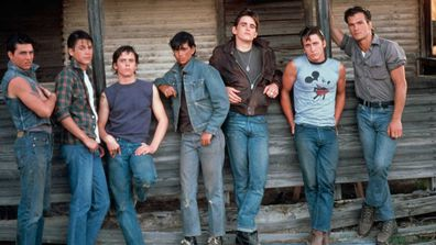 Tom Cruise, Rob Lowe, C. Thomas Howell, Ralph Macchio, Matt Dillon, Emilio Estevez and Patrick Swayze on the set of The Outsiders.