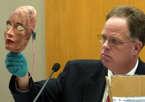Wichita Police Detective Sam Houston shows a mask, which was used in one of the crimes, during Dennis Rader's 2005 sentencing hearing in Wichita, Kansas. Rader of Park City, Kansas pleaded guilty to the 10 killings dating back to 1974.