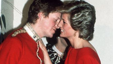 Princess Diana greets her brother Charles at a charity ball.