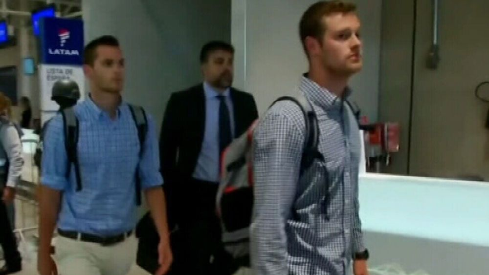 US swimmers granted permission to leave following police probe