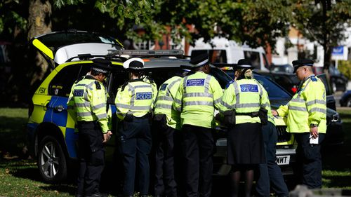 Police fill the park in the middle of Parsons Green. (AAP)