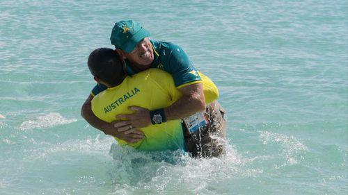 Dane Bird-Smith hugs his father and coach David Smith. (AAP)
