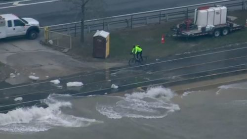 A brave cyclist is seen dodging chunks of ice. (ABC-7 Chicago)