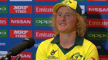 Delivers cheeky grin and answers in interview