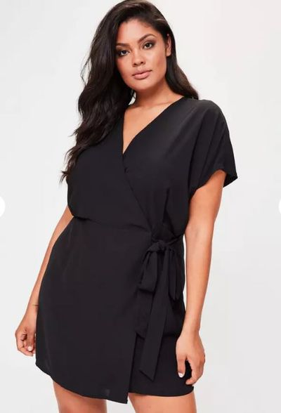 """<a href=""""https://www.missguidedau.com/plus-size-kimono-sleeve-wrap-dress-black"""" target=""""_blank"""">Misguided Plus Size Kimono Sleeve Wrap Dress in Black, $56.95.</a>"""