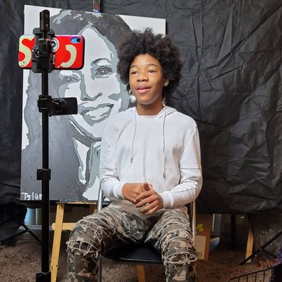 Tyler Gordon 14, paints Kamala Harris