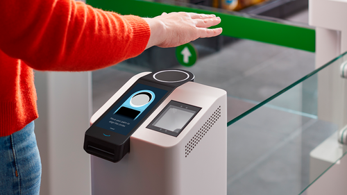 This undated photo provided by Amazon shows the Amazon One device at an Amazon Go store in Seattle. Amazon has introduced the new palm recognition technology in a pair of Seattle stores and sees broader uses in places like stadiums and offices.  Customers at the stores near Amazon's campus in Washington can flash a palm for entry and to buy goods. (Amazon via AP)
