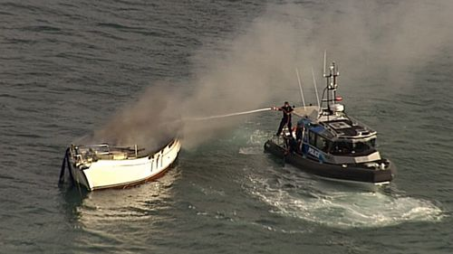 News Queensland yacht fire Moreton Island Brisbane news Australia
