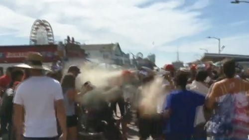 Man sprays bear repellent during California Trump protest