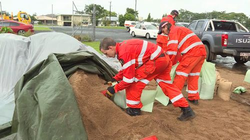 Sandbagging stations have been set up to assist people with preparing their homes for the rain in Queensland. (9NEWS)