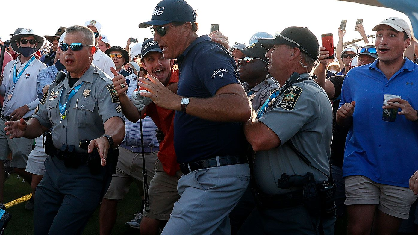 Phil Mickelson fights his way through the crowd on the final hole of the PGA Championship at Kiawah Island.