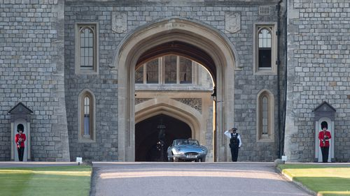 The newlyweds leave the grounds of Windsor Castle. Picture: EPA