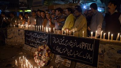"Pakistani journalists light candles for the victims. (Getty Images) <br _tmplitem=""7""> <br _tmplitem=""7""> The attack has been condemned world-wide by world leaders."