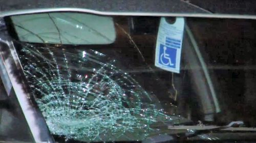 A smashed windscreen of a car at the scene of the crash.