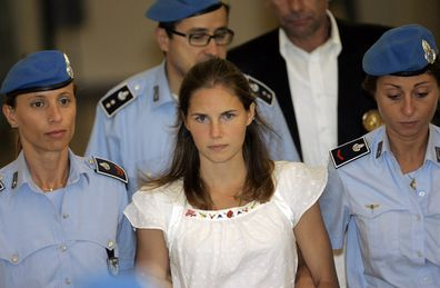 Amanda Knox being escorted by Italian penitentiary police officers from Perugia's court after a hearing, central Italy, Tuesday Sept. 16, 2008.