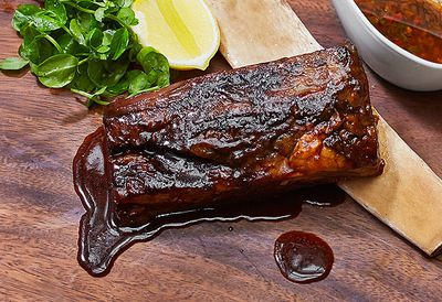 """Recipe: <a href=""""/recipes/ibeef/8997995/the-emporiums-slow-cooked-beef-short-ribs-with-maple-glaze"""" target=""""_top"""">Slow-cooked beef short ribs</a>"""