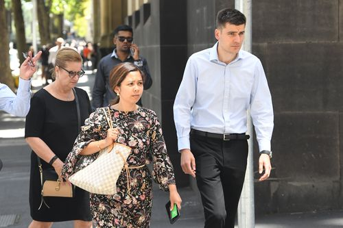 Nawwar Hassan (centre) and Matthew Bryant (right), the parents of Zachary and Zara Bryant.