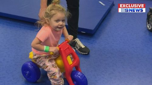Three-year-old Hayley Henwood is learning how to walk and talk again.