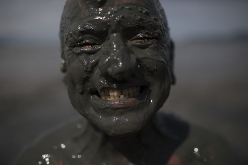 Hundreds of people took part in the muddy fun. (AP)