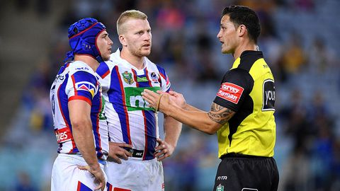 Referee Henry Perenara gestures to Jamie Buhrer, (left), and Mitchell Barnett of the Knights