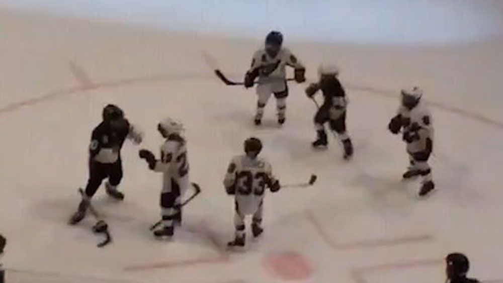 Kids duke it out during ice hockey brawl