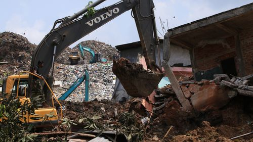 Sri Lankan military rescue workers carry out a rescue operation at the site of a collapsed garbage dump in Colombo. (AFP)