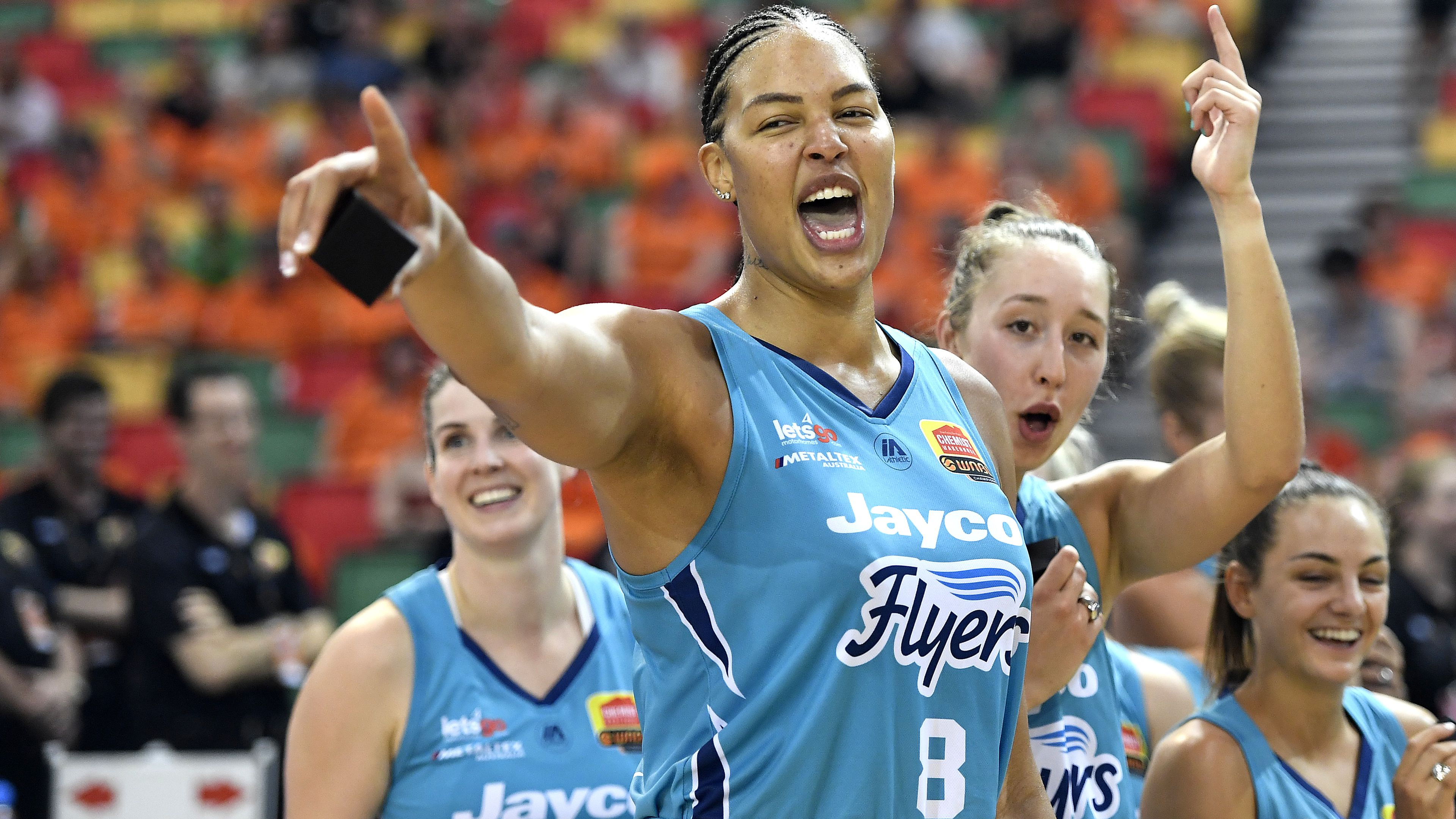 Liz Cambage and the Southside Flyers celebrate victory.