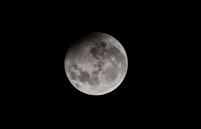 Maximum phase of Penumbral Lunar eclipse at Nehru Planetarium, on January 10, 2020 in Mumbai, India.