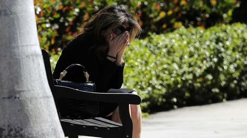 A mourner is overcome with grief at Meadow Pollack's funeral. (AAP)