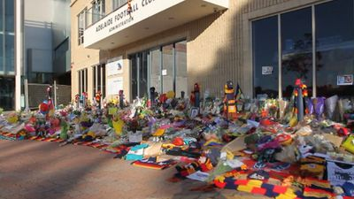 Floral tributes outside the Adelaide Crows' administration building. (9NEWS)