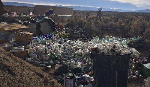 Empty glass bottles - just one of the materials used in construction of earthships. (9NEWS)