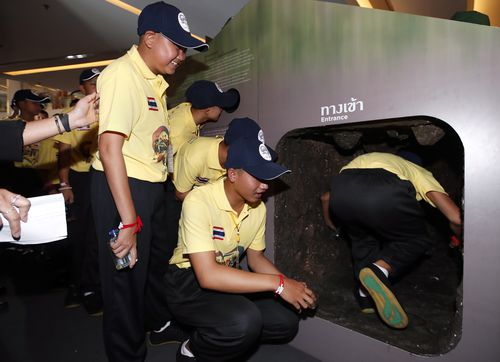 The event at the Bangkok shopping centre saw the boys re-enact crawling through the caves.
