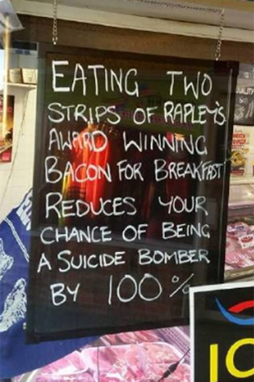 NSW butcher says he didn't mean to offend with 'bacon bomber' sign
