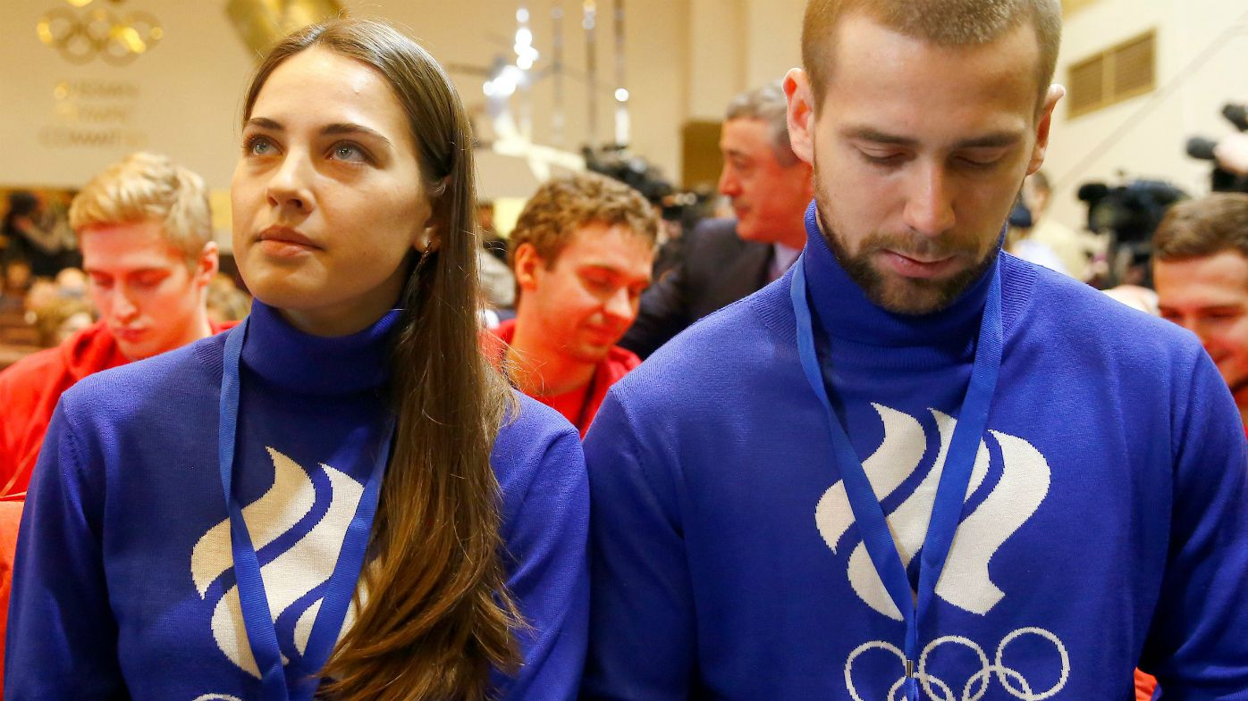 Russian curling players Anastasia Bryzgalova (L) and Alexander Krushelnitsky
