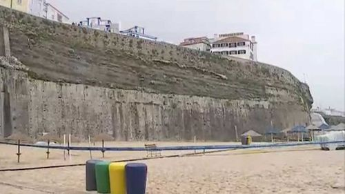 The large stone wall sits 30m above the popular surf beach. Picture: Correio Da Manha