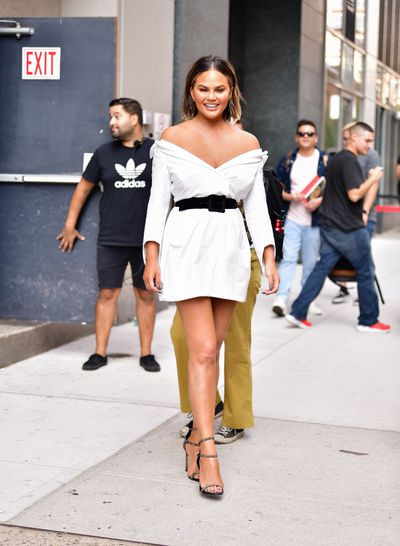 The mum-of-two made another quick change and highlighted her glowing skin in an off-shoulder white dress which was cinched at the waist with a velvet black belt and matched with snake skin heels.