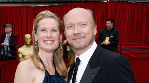 "Screenwriter Paul Haggis, right, nominated for best original screenplay for his work on ""Letters from Iwo Jima"", arrives with his wife Deborah Rennard, for the 79th Academy Awards on February 25, 2007. (AAP)"
