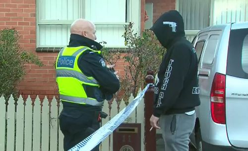 They could be seen speaking to police, wearing sweaters that read 'F--- you'. Picture: 9NEWS