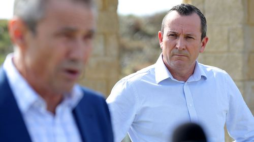 Western Australia Health Minister Roger Cook speaks to the media as Premier of Western Australia Mark McGowan looks on