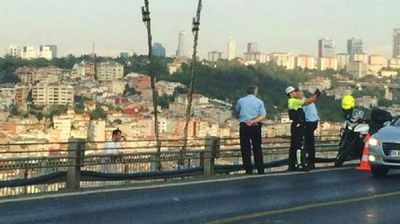 A Turkish police officer could face criminal charges after he was sprung posing for selfie moments with a suicide jumper moments before he fell to his death in the Turkish capital of Ankara. (Supplied)