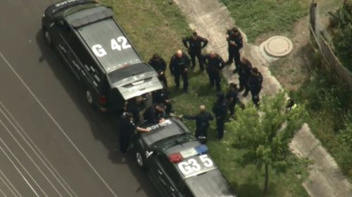 Man arrested after barricading himself inside Melbourne home