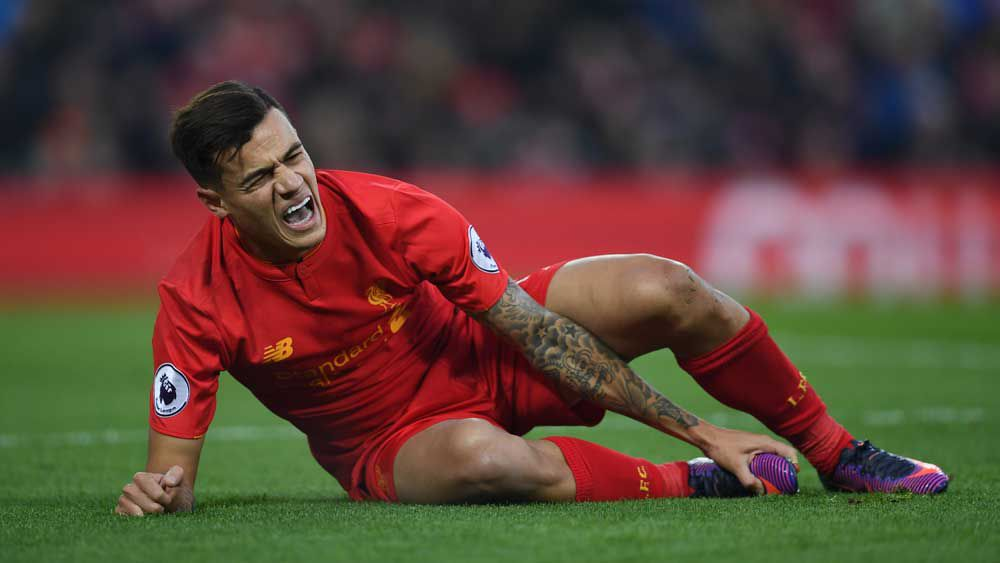 Liverpool star Philippe Coutinho goes down with injury. (AFP)